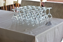 Inverted Clean Glasses On The Table In The Restaurant