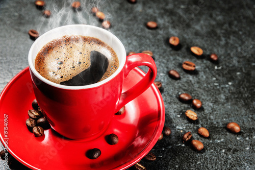 cup of fresh coffee with coffee beans on stone table Canvas Print