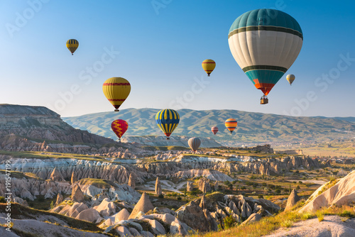 Spoed Foto op Canvas Ballon Hot air balloons flying over Cappadocia, Turkey
