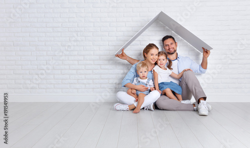 Obraz concept housing a young family. mother father and children in  new home. - fototapety do salonu