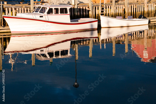 Photo  White Boats Alongside Wharf