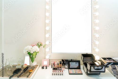 Modern closet room with make-up vanity table, mirror and cosmetics product in flat style house Fototapeta