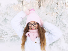 Adorable Happy Young Blonde Woman In Pink Knitted Hat Scarf Having Fun Snowy Winter Park Forest In Nature