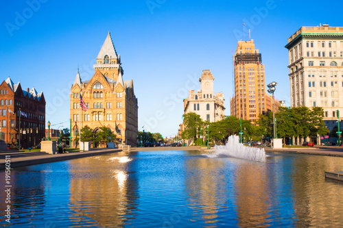 Fényképezés  Downtown Syracuse New York with view of historic buildings and fountain at Clint