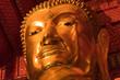 Closed up of The face of gold Buddha. The big gold Buddha statue face close up at wat phanan choeng in Ayutthaya.