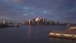 sunset flying backward from Manhattan view revealing crane on left