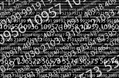 Fotografía Abstract background image of a set of consecutive five-digit white numbers of different sizes on a black background in a diagonal direction