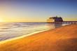 Leinwandbild Motiv Pier and building on sea and beach. Follonica, Tuscany Italy