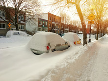 Cars Covered With Snow On Wint...
