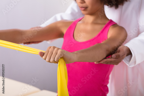 Fotografie, Obraz  Woman Exercising With Exercise Band