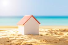 House Model On Sandy Beach