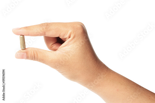 Fotografia Hand with a pill herb isolated clipping path