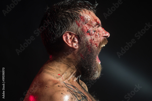 Fotografiet  Hipster shout with bloody beard on brutal face profile