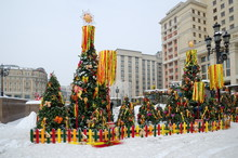 "Moscow, Russia - February 8, 2018: The Festival ""Moscow Maslenitsa 2018"" At The Manege Square. Decorated Fir Trees With Symbols Of Shrovetide"