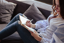 Beautiful Young Woman With Schedule Notebook In Stylish Home Interior. Freelancer Business Lady In Her Working Place.