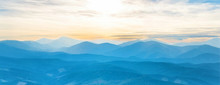 Blue Mountains At Sunset Sky. Panorama View Of Peaks Ridge