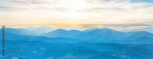 Valokuva Blue mountains at sunset sky. Panorama view of peaks ridge