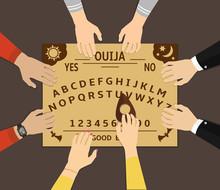 Ouija Board Playing. A Group O...