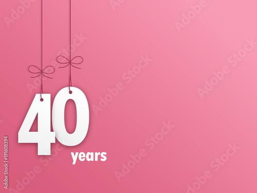 Fotografia  Suspended Number 40 on pastel pink background