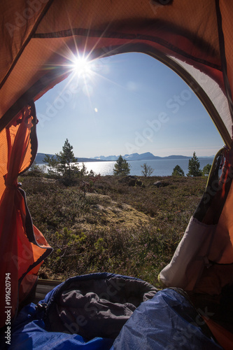 Fotobehang Kamperen View from tent to sea and mountains on the Lofoten islands at the summer