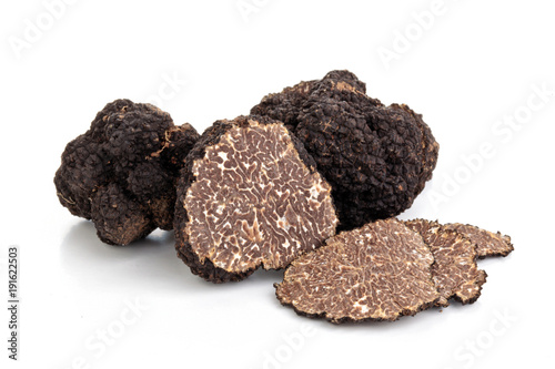 Black truffles and oak leaves.