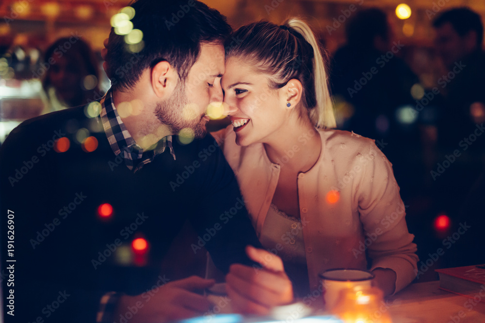 Fototapety, obrazy: Romantic couple dating in pub at night