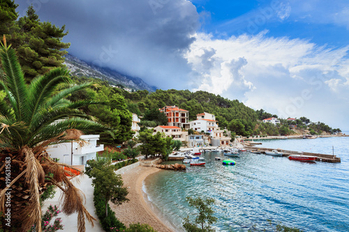 Fotobehang Liguria Croatian Adriatic sea coast with harbor with clouds on the sky