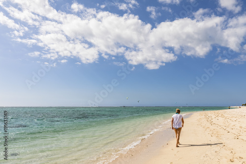 Mauritius, Southwest Coast, Indian Ocean, beach of Le Morne, female tourist at beach