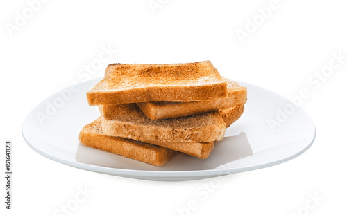 Plate with toasted bread on white background Canvas Print