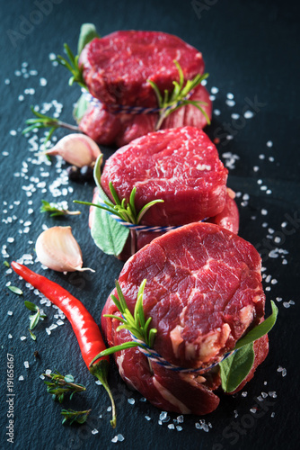 Cuadros en Lienzo Raw beef fillet steaks mignon on dark background