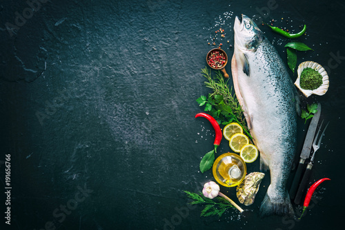 Canvas Prints Fish Fresh salmon fish with seasoning on black stone