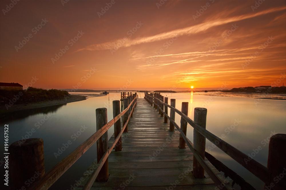 Fototapeta old sea pier at sunrise