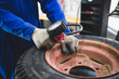 Mechanic repairing tire. Worker vulcanize used tire.