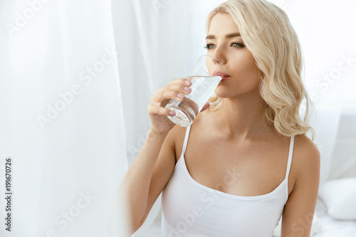 Leinwand Poster Drinking Water. Woman With Glass Of Water.