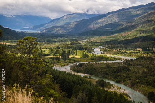 Landscape of Blue river, valley and forest in El Bolson, argentinian Patagonia Wallpaper Mural