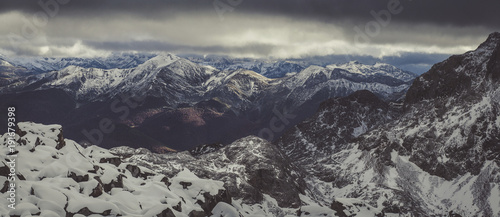 Panoramic view of mountains against stormy clouds during winter