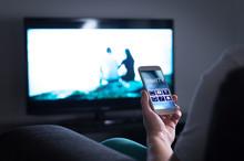 Man Watching Television And Us...