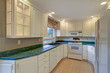 Freshly renovated kitchen room with white cabinetry