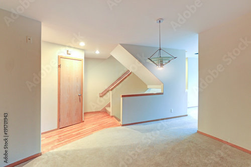 Empty Apartment Interior Features White Walls And Beige Carpet Floor