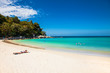 Unidentified people are relaxing on Kata beach in Phuket, Thailand.