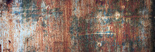 Rusty Metal Texture With Flaking Paint. Panoramic Background Of Old Iron And Rust