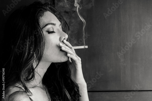 Canvastavla Fashion portrait of  beautiful woman sexy slim body smoking cigarette