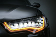 Leinwandbild Motiv headlight of prestigious car closeup