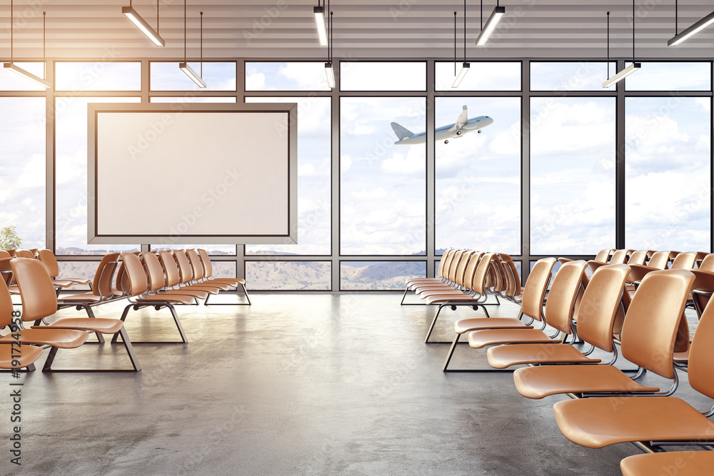 Fototapeta Modern airport interior with blank poster