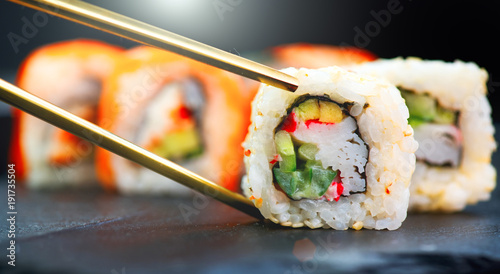 Recess Fitting Sushi bar Sushi rolls. Japanese food in restaurant. Sushi roll set california with salmon, vegetables, flying fish roe and caviar closeup