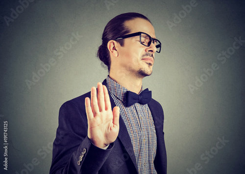 Fotografering  Offended man giving stopping gesture