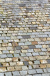 Old weathered multi coloured roof slate tiles full frame
