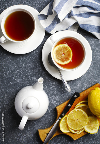 Poster Thee Cup of tea with lemon, top view