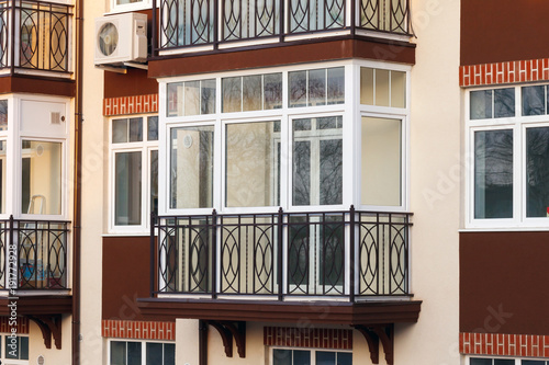 Glazed balcony in a modern apartment building.
