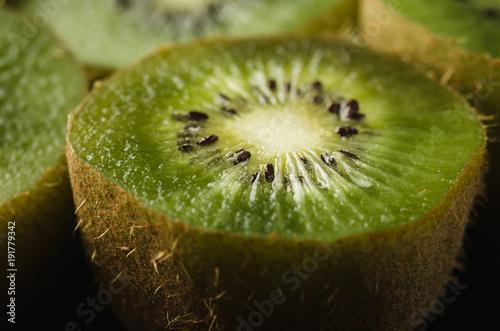 Ripe fresh kiwi on black background/Ripe fresh kiwi on black background. Close up